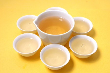 White Cup of tea  on yellow background photo