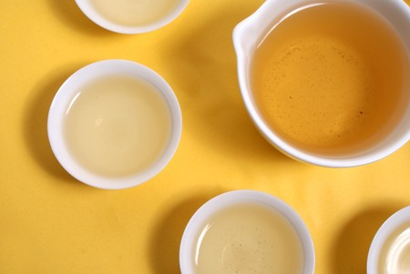 White Cup of tea  on yellow background Stock Photo - 8177548