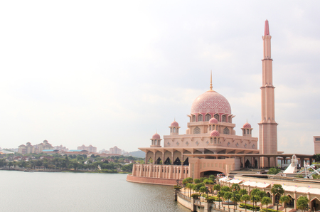 principal: PUTRAJAYA, MALAYSIA - 09 August 2014; Sunrise moment at Putra Mosque is the principal mosque of Putrajaya, Malaysia. Construction of the mosque began in 1997 and was completed two years later.