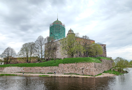 city park boat house: Russia May 24, 2017. Ancient fortress in the city of Vyborg.Part of ancient building at sunset in Vyborg, Russia. Vyborg is 174km northwest of St Petersburg and just 30km from the Finnish border.