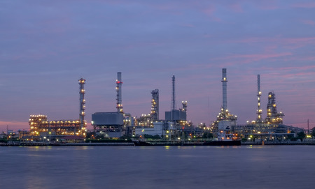 river side oil refinery industry plant along twilight morning,pink sky, Bangkok Thailand