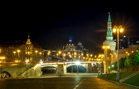 spasskaya: RUSSIA, MOSCOW MAY 27, 2017: The twightlight from the Red square behind the Saint Basil Church, night view beautiful, and the bridge into the Red square and Kremlin Palace. Editorial