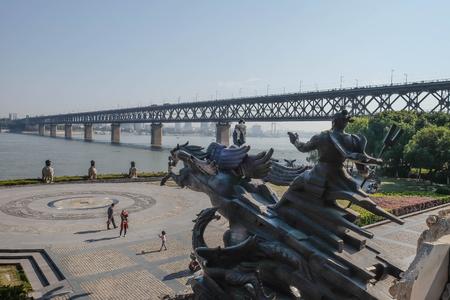 WUHAN  Nov 05 2017: Dayu Shenhua Park at riverside of yangtze river bridge at hubei province, China, it is the first yangtze river bridge. Editorial