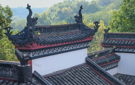 The roof of Chinas hubei province wuhan to old palace Can be see double deck bridge at Wuhan Yangtze River Bridgebuilt in 1957. It's famous for travel. Many people come to relax at evening time.