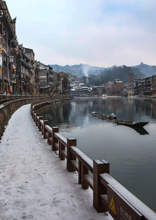 FENGHUANG, HUNAN, CHINA - JANUARY 26 2018: Unidentified tourists at The Old Town of Phoenix (Fenghuang is Specific name). The popular tourist attraction which is located in Fenghuang County, Editorial