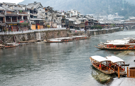 FENGHUANG, HUNAN, CHINA - JANUARY 25, 2018: Unidentified tourists at The Old Town of Phoenix (Fenghuang is Specific name). The popular tourist attraction which is located in Fenghuang County,
