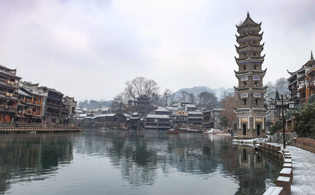 FENGHUANG, HUNAN, CHINA - JANUARY 25, 2018: Unidentified tourists at The Old Town of Phoenix (Fenghuang is Specific name). The beautiful old town in the morning. At the winter time.