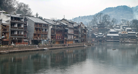 FENGHUANG, HUNAN, CHINA - JANUARY 25,2018: Unidentified tourists at The Old Town of Phoenix (Fenghuang is Specific name). The popular tourist attraction which is located in Fenghuang County,