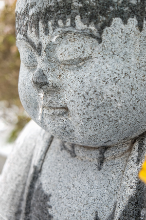 Close Up Of Stone Buddha Garden Statue Covered In Snow Stock Photo    98673057