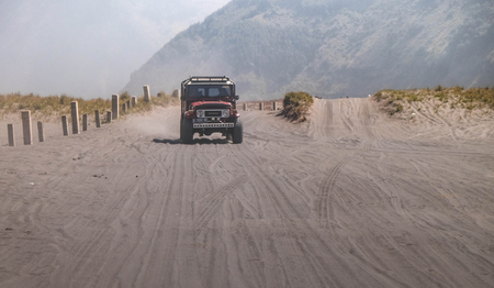 Bromo Mountain , Indonesia - JULY 17 , 2018 : The jeep car is driving at the area of Bromo Mountain Surabaya Indonesia. this car is famous for travelor. Editorial