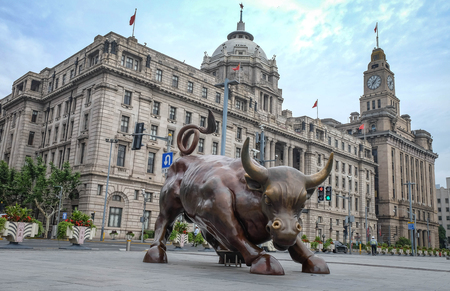 SHANGHAI - JUN 22 , 2018: Bronze bull on The Bund in Shanghai, Iron bull statue out front of Chinese banks on the Bund, Shanghai