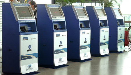 Wuhan , China - September 10 ;  Kiosk self check-in machines in Terminal 3 at Tianhe International Airport. 新聞圖片