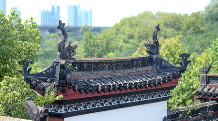 Wuhan China - September 08 2018 : Chinas hubei province wuhan to old palace with ancient chinese poetry tourists. The some statue on the roof of this palace.