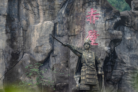 CHIBI, HUBEI/ CHINA - OCT 25 2018: Statues of  Zhou Yu (Especially name) It's locted at The Three kingdoms battles field. It's a scene of  The red cliff movies .It's sculpture made of natural stone.
