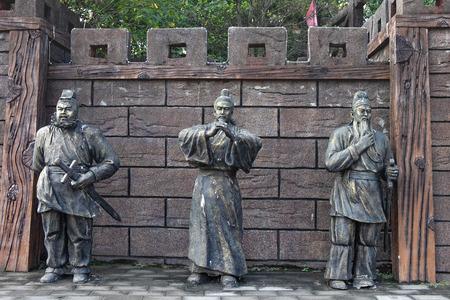 CHIBI, HUBEI CHINA - OCT 25 2018: Statues of Guan Yu, Liu Bei and Zhang Fei (Oath of the Peach Garden) in Peach garden. At the Three kingdom Chibi Battle field. Chibi, China