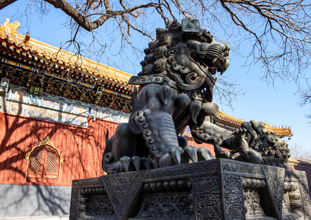 Ancient bronze lion and red chinese paviliones in famous Lama Temple.  This here is one of the destination for travel.  It's builded at 1964 has the Tibetian style.
