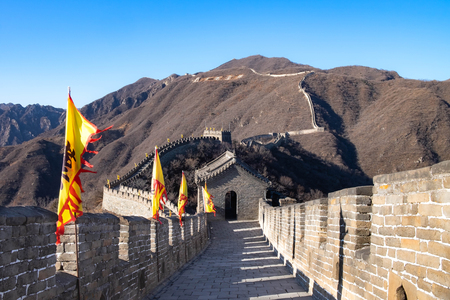 The ancient flag along the great wall. The great wall name's MU TIAN YU. At the winter time. The most longest wall in the world.