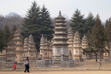 Dengfeng, HenanChina- JANUARY 20, 2019: The Unspecifec man walking in Talin Pagodas, It's memorial of the high priest of Shaolin temple. Located in the part of Shaolin temple, Songshan Mountain, Dengfeng city Henan province, China.