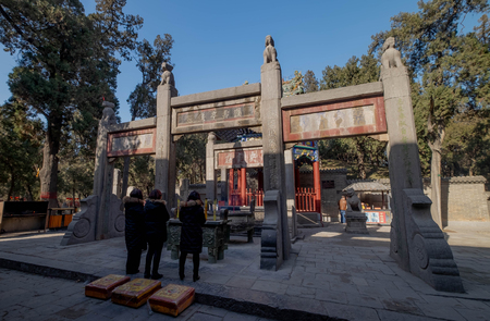 Luoyang, HenanChina- JANUARY 20, 2019: Three unspecific women respect the tomb of  Guan Yu at Guanlin Temple. It's the place where the Guan Yu's head was bury. Guan Yu is the one of the God of Chinese people.