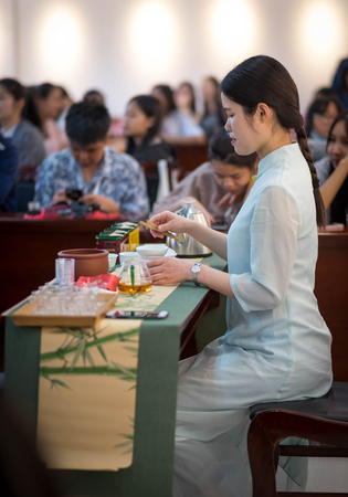Wuhan, Hubei China- APR 07-2019: Chinese tea ceremony set the show for exchange student, It's a ancient ceremony of China. Focus onlu on the cup of tea. 에디토리얼