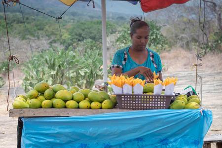 SIGIRIYA SRI LANKA, AUGUST 06-2019: Unspecific woman selling the mango on her table, It's a local vendor in Sri Lanka.