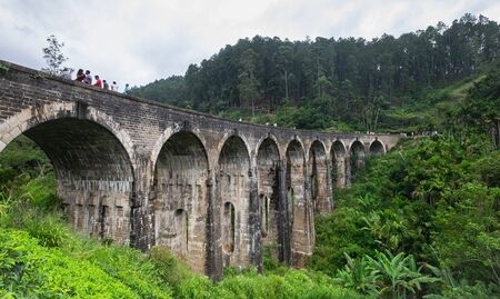 ELLA/ DEMODARA, SRI-LANKA: AUGUST 08/ 2019: The Nine Arches Demodara Bridge. Many tourists in this here, This one of the destination for tourism.