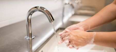 Closeup woman washing hand with soap and running water for coronavirus protection, Hygiene to stop outbreak covid-19 concept.