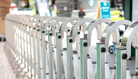 Automatic stainless steel Barrier Gate or folding fence temporary gate for protection, prevention security people and car from outside at the entrance of department store.