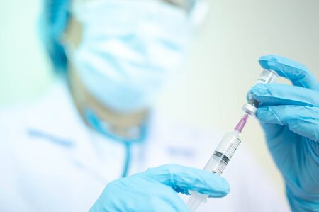 Syringe medical injection in hand holding with medicine dose vaccination equipment with needle. vaccination to patient for coronavirus (COVID-19) protection. Coronavirus pandemic world of crisis. Standard-Bild