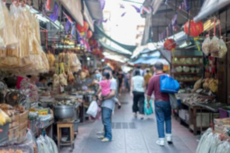Abstract blurred effect View of street food in Bangkok city  Thailand. Many people walking at the alley of Chinatown center of Bangkok. Фото со стока