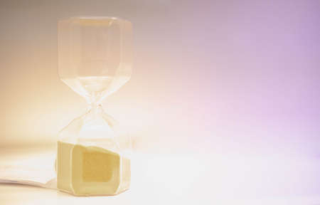 Sand running through the hourglass measuring the passing time in a countdown to a deadline, Hourglass time concept for rush and run out of time., business deadline.