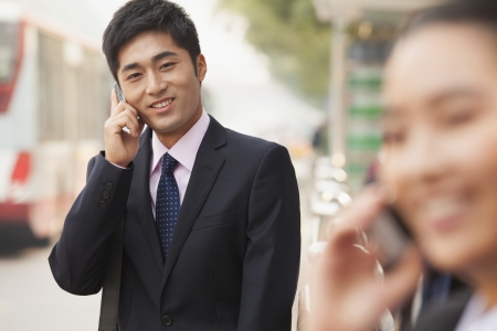 Young Businessman on the phone, portrait, Beijing photo