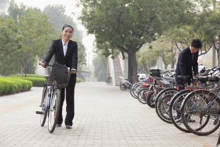 Young Business people parking their bikes in Beijing photo