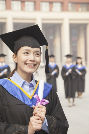 Young Female Graduate Holding Diploma Imagens - 35986503