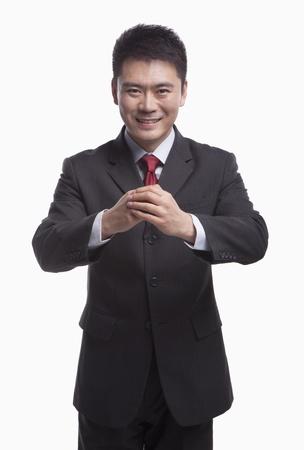 bowing: Businessman Bowing Toward Camera