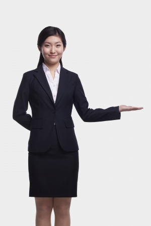hand out: Young Businesswoman With Hand Out Stock Photo
