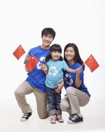 Family Portrait, one child with parents, waving Chinese flags, studio shot photo