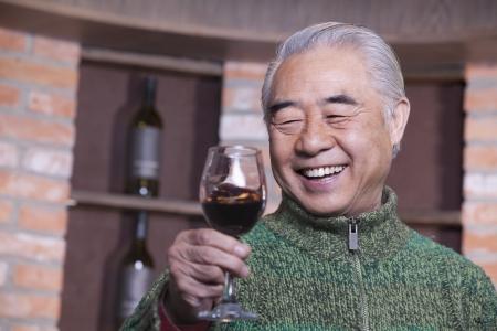 Senior Man Holding Wineglass, Portrait  Stok Fotoğraf