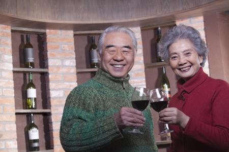 Senior Couple Toasting with Wine Glass photo