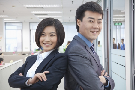 Two Business People with Arms Crossed photo