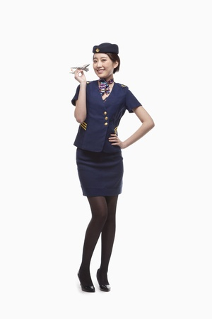 Portrait of Air Stewardess Holding Model Airplane Stok Fotoğraf - 35986270
