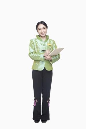 acomodador: Restaurante  Hotel Anfitriona en el tradicional celebraci�n portapapeles ropa china