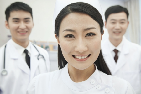 Portrait of Two Doctors and Nurse, China photo