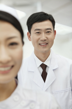 Portrait of Doctor, Nurse in foreground photo