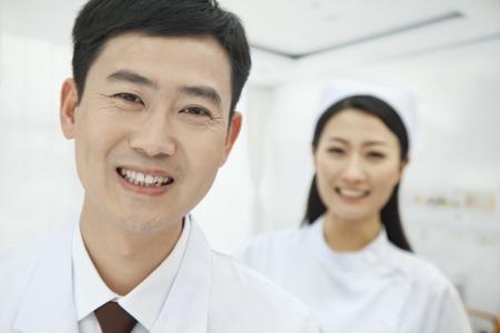 Portrait of Doctor, Nurse in Background photo