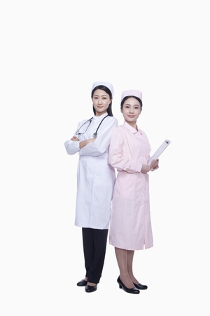 Portrait of two young nurses, studio shot photo