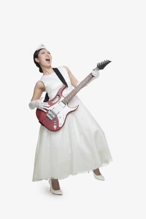 counterculture: Princess Singing with Rock Guitar Stock Photo