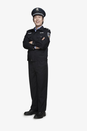 police officer: Policeman Standing and Smiling