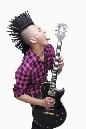 mohawk: Young man with punk Mohawk playing guitar