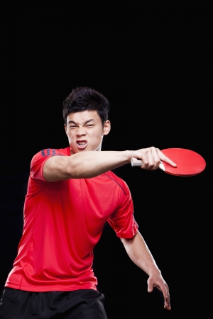 Man playing ping pong, black background Imagens - 35985781